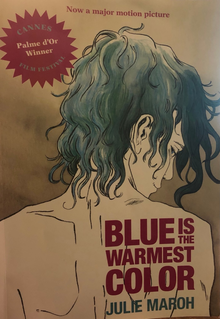 Front cover of Blue is the Warmest Colour by Julie Maroh. It shows Emma with her distinctive blue hair looking over her shoulder slyly at the viewer.